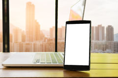 Smartphone white screen with city building background, blank. Smartphone white screen with city building background Royalty Free Stock Photo