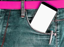 Smartphone with  white screen with empty space for text in a denim jeans pocket. Smartphone with  white screen with empty space for text in a denim jeans pocket Royalty Free Stock Photos