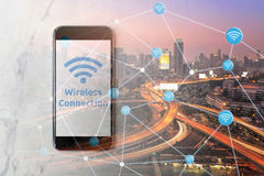 Smartphone with wifi network on screen and Smart city Royalty Free Stock Photography