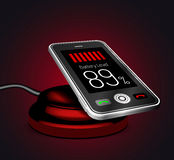 Smartphone on a wireless charge Stock Image