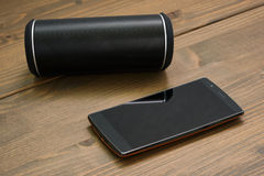 Smartphone and Wireless speaker Royalty Free Stock Images