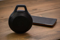 Smartphone and Wireless speaker Stock Photos