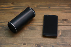 Smartphone and Wireless speaker Royalty Free Stock Photography
