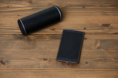 Smartphone and Wireless speaker Royalty Free Stock Photos