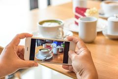 Woman capturing photo of morning meal set Stock Image