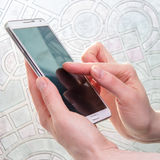 Smartphone in woman hand Stock Photography