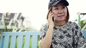Smartphone woman talking on phone in park stock video footage