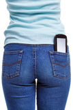 Smartphone in womans rear pocket Stock Image