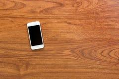 Smartphone on wood background. Blank screen smartphone on wood background Stock Image