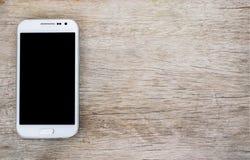 Smartphone on wood background stock photo