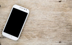 Smartphone on wood background stock photography
