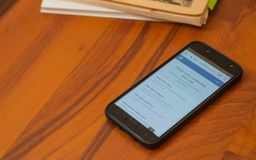 Smartphone on a wooden background. Royalty Free Stock Images
