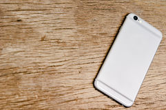 Smartphone on the wooden table royalty free stock photo