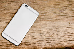 Smartphone on the wooden table stock photo