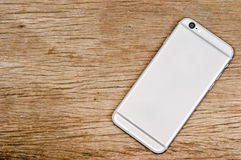 Smartphone on the wooden table stock image