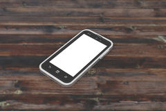 Smartphone on a wooden table with a blank screen Royalty Free Stock Photo