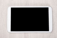 Smartphone at wooden table Royalty Free Stock Images