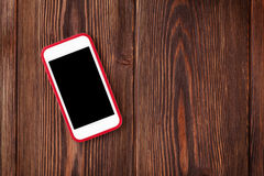 Smartphone on wooden table Royalty Free Stock Image