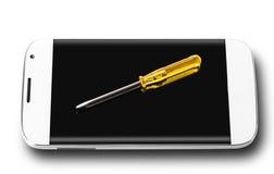 Smartphone y destornillador fotografía de archivo libre de regalías
