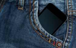 Smartphone in your pocket blue jeans Royalty Free Stock Image