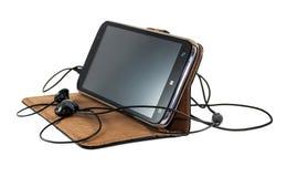 Smartphone z hełmofonami Zdjęcia Stock