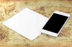 Smartphoneon a world map Stock Photo