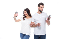 smartphones пар используя Стоковые Фотографии RF