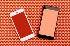 2 smartphones с пустым экраном, глумятся вверх по космосу экземпляра Стоковое Изображение