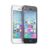 Smartphones blancos y negros con los iconos coloridos del uso en t Imagen de archivo libre de regalías