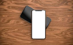 Smartphones with blank screen, isolated on wooden background. royalty free stock images