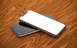 Smartphones with blank screen, isolated on wooden background. royalty free stock photos