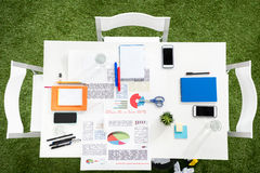 Smartphones with blank screens, papers and office supplies at workplace Stock Image