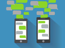 Smartphones with blank speech bubbles Royalty Free Stock Photography