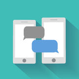 Smartphones with blank speech bubbles Stock Images