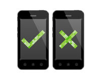 Smartphones with check and cross symbol Stock Images