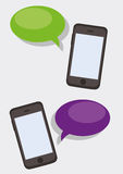 Smartphones with dialog boxes Stock Image