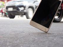 Smartphones drop to the ground. Make the screen broken and damaged.Background image blur With the concept of accident. Insurance technology, repair and stock image