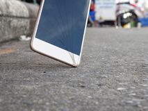 Smartphones drop to the ground. Make the screen broken and damaged.Background image blur With the concept of accident royalty free stock image