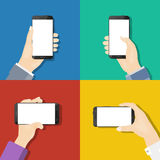 Smartphones in hands. Flat design royalty free illustration