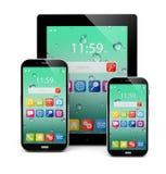 Smartphones lucidi neri del PC e dello schermo attivabile al tatto della compressa Fotografia Stock
