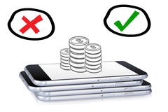 Smartphones múltiplos com as moedas nele Imagens de Stock Royalty Free