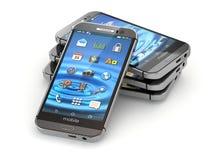 Smartphones ou téléphones portables sur le fond blanc Image libre de droits
