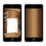 Smartphones with paper and pencil, ruler, eraser, sharpener on lath boards. Wooden wallpaper. Royalty Free Stock Photography