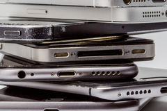 Smartphones are piled up together,. Iphone, devices mobile devices shows huge consumer demand for latest technologies. Android device. Wearable technology Royalty Free Stock Photo