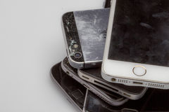 Smartphones are placed one to another, laying on the table side is visible only. Iphone, devices mobile devices shows huge consumer demand for latest Royalty Free Stock Images