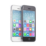 Smartphones preto e branco com ícones coloridos da aplicação em t Imagem de Stock Royalty Free