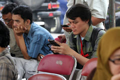 Smartphones. Reporters were sent a message by using a smartphone in the city of Solo, Central Java, Indonesia Royalty Free Stock Images