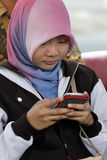 Smartphones. Reporters were sent a message by using a smartphone in the city of Solo, Central Java, Indonesia Royalty Free Stock Photo