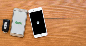 2 smartphones showing UBER and GRAB application Royalty Free Stock Photo