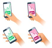 The smartphones with stock quote charts on the screens. stock photos